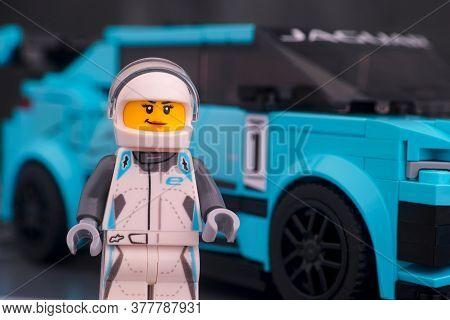 Tambov, Russian Federation - February 19, 2020 Lego Jaguar I-pace Etrophy Driver Minifigure Against