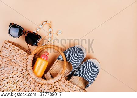 Summer Fashion Flatlay With Summer Straw Bag, Striped Espadrilles Sandals, Sea Shell Necklace, Sunsc