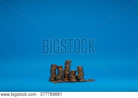 Pile Of Golden Coins Isolated On Blue.