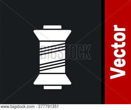 White Sewing Thread On Spool Icon Isolated On Black Background. Yarn Spool. Thread Bobbin. Vector Il