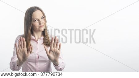 Young Caucasian Woman Gesturing Stop Or Saying No With A Smile, With Flirt And Coquetry, Extending H