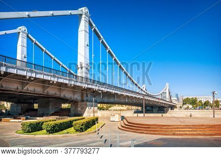 Arches Of The Crimean Bridge Over The Moskva River In Moscow And An Empty Embankment On An Early Sun