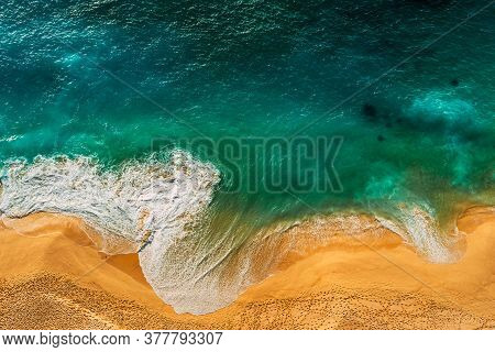 Seascape Top View. Panoramic View Of The Sea Waves. Foamy Waves Roll Over The Seashore. A Vivid Pict