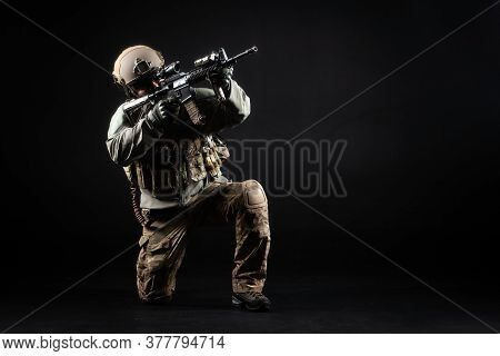 American Special Forces, A Soldier In A Military Uniform With A Weapon Attacks On A Black Background