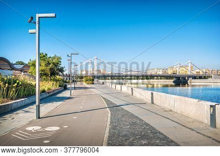 View Of The Crimean Bridge From The Crimean Embankment Of Muzeon In Moscow On A Summer Sunny Morning