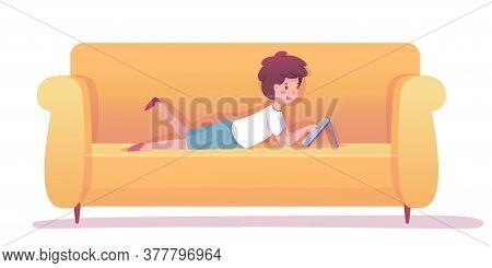 Little Preschool Boy Or Schoolboy Watching Cartoon, Play Video Game, Chatting On Digital Tablet Lyin
