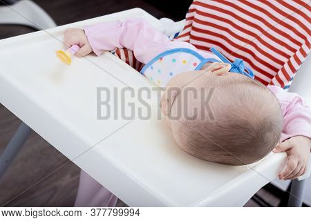 Sleeping Baby With Spoon In His Hands Fell Asleep During Eating