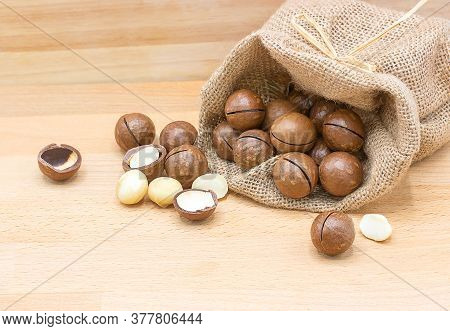 Macadamia Nuts Isolated On A Wooden Background With Copy Space