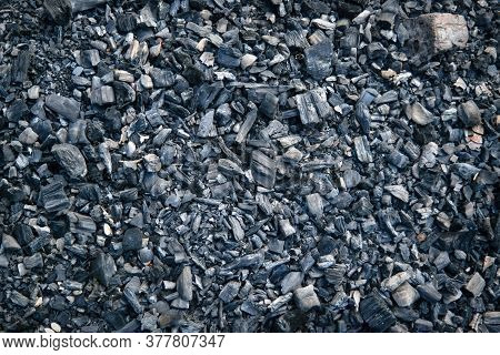 Black Charcoal Texture Background. Close-up Shot. Top View. Close-up Charcoal Texture.