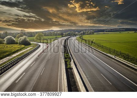 Autobahn Landscape In Germany In Summer With Dramatic Clouds