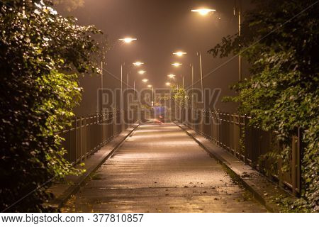 Moody bridge with hazy air at night in Fussen, Germany.