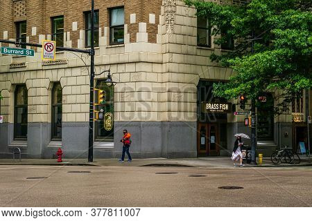 Vancouver, Canada - June 10, 2020: Burrard Street View In Downtown With People During Rainy Day