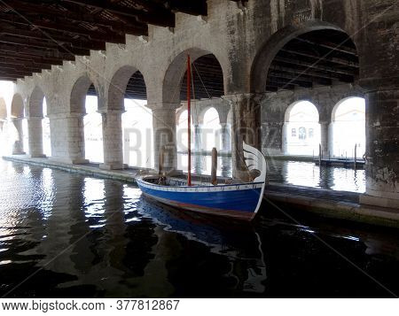 Venice, Arsenal Docks With Arched Passages And An Old Boat
