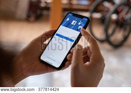 Chiang Mai, Thailand - Feb 26, 2020: Woman Hold Apple Iphone Xs With Facebook Application. Facebook