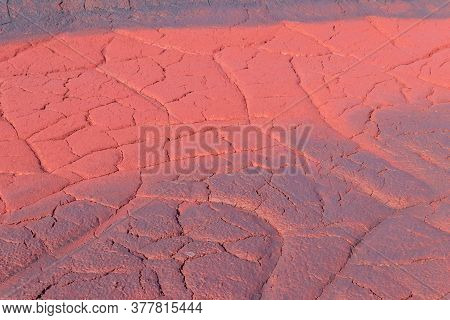Texture Of Red Wet Ground Polluted With Iron Ore Waste