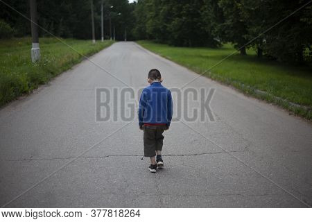 The Child Is Alone On The Road. The Boy Is Lost And Goes Forward. The Younger Student Was Offended A