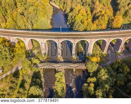 Aerial View Of Old Stone Railroad Bridge Crossing River Near Village Of Coo In The Ardennes, Belgium
