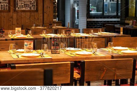Nakhon Ratchasima, Thailand-march 13, 2020: Dinner Table Set In Restaurant At Night