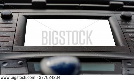 Black Automobile Dashboard With Various Buttons White Display And Blurry Blue Gear Stick On Foregrou