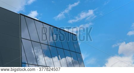 Highrise Building Upper Floors Against White Clouds In Incredible Blue Sky Reflected In Building Pan