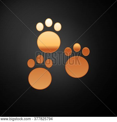 Gold Paw Print Icon Isolated On Black Background. Dog Or Cat Paw Print. Animal Track. Vector