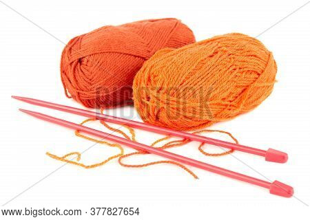 Two Knitting Yarn Clews And Knitting Needles Isolated On White Background.