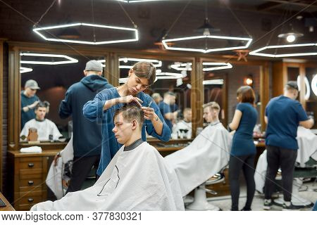 Side View Of Professional Barber Girl Or Female Hairstylist Serving Client, Making Trendy Haircut Fo