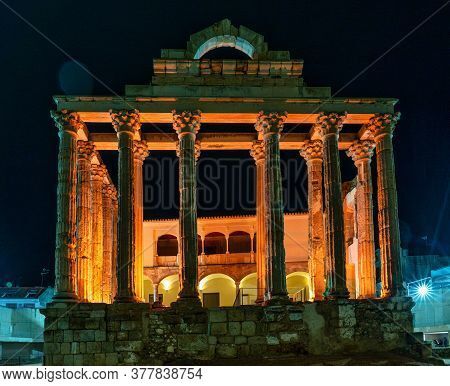 Merida, Spain - November 04, 2019: The Roman Temple Of Diana In Merida Illuminated At Night, Provinc
