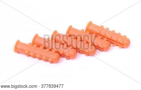 Group of plastic dowels isolated over white background
