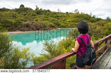 Tourist Looking To  The View Of Green Lake (roto Kanapanapa In Maori Language) Setting In The Centre