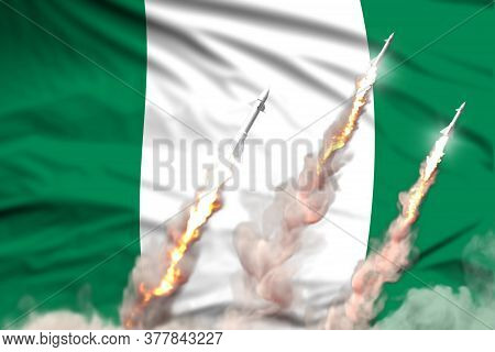 Nigeria Nuclear Warhead Launch - Modern Strategic Nuclear Rocket Weapons Concept On Flag Fabric Back