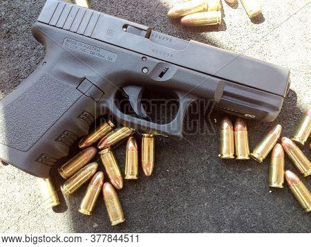 Bullets 9mm 40 Caliber Close Up With Glock Handgun Firearm Pistol
