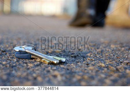 A Man Lose Keys On The Road. Losing Keys Concept.