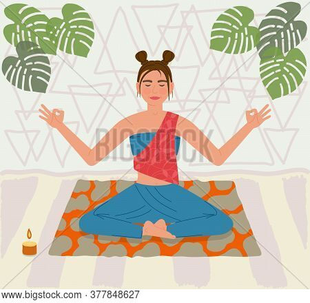 Young Woman Sitting In Yoga Posture On Mat And Do Meditation At Home. Girl Smiling Closing Her Eyes.