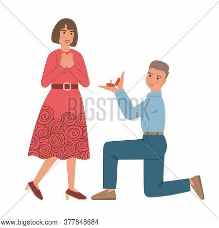 Man Makes Marriage Proposal To Woman. Boy Kneeling Down Holds Out A Box With A Wedding Ring To A Gir