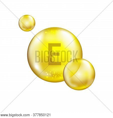 Vitamin E Premium Icon. Cosmetic Skin Care Complex Concept. Bright Shiny Capsule. Gold Oil Capsule.