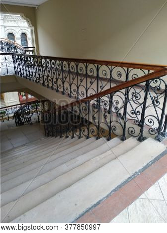 Old Stairs With Wrought-iron Railings. Step. Beautiful Wooden Railing.