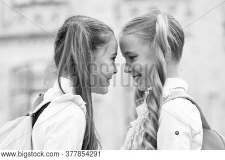 Soulmate Friends. Small Schoolgirls Wear School Uniform. Cute Schoolgirls With Long Ponytails Lookin