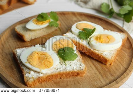 Tasty Sandwiches With Boiled Eggs On Wooden Tray, Closeup