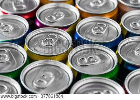Aluminum Cans With Carbonated Water, Energy Drinks Or Beer. Background Of Aluminum Cans