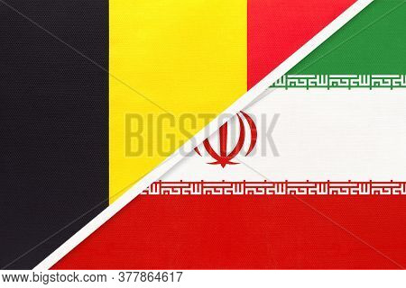 Belgium And Iran Or Persia, Symbol Of Two National Flags From Textile. Relationship, Partnership And