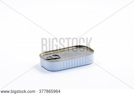 Canned Fish In Sealed Oval Tin Can With Easy Openable Lid On A White Background