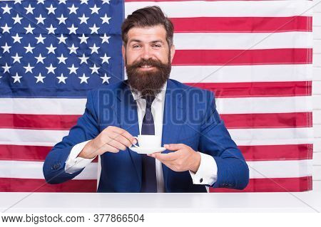 Businessman With American Flag And Coffee. Politician Drink Coffee. Bearded Businessman Patriotic Fo