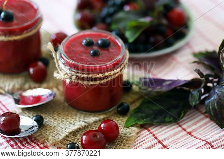 Selective Focus. Detox Smoothie With Cherries And Black Currants. Smoothie With Berries And Basil. V