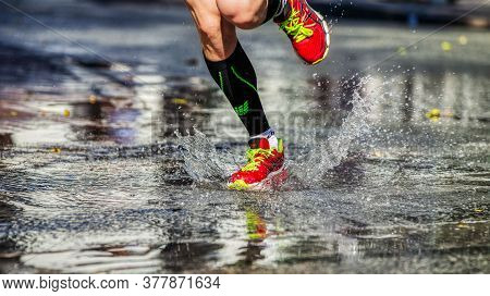 Ekaterinburg, Russia - August 7, 2016: Legs Man Runner In Running Shoes Asics And Compression Socks