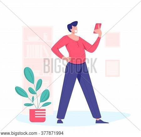 Smiling And Surprised Standing Man Looking Smartphone Indoor. Close Up Young Man, Glad Looking At Di