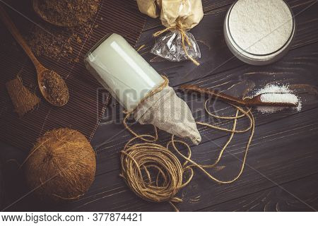 Coconut Oil With Fresh Nut On Old Wooden Table