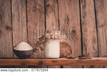 Coconut Shavings And Coconut Oil On Black Background. Coconut With Coconut Flakes