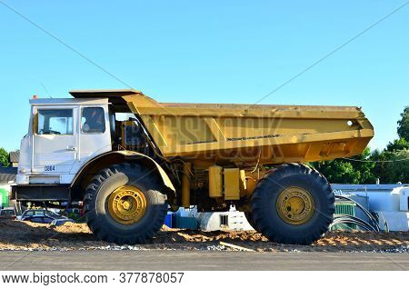Big Yellow Dump Truck Working On The Construction Site - Image