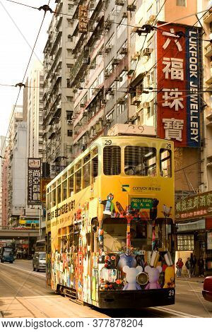 Causeway Bay, Hong Kong Island, Hong Kong, China - December 05, 2008: Traditional Tram And Store Sig